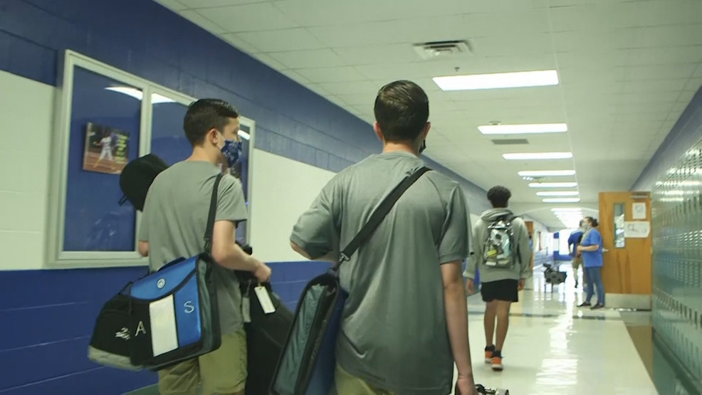 FILE Students walk with masks in a school hallway  during the COVID-19 pandemic (SBG San Antonio)