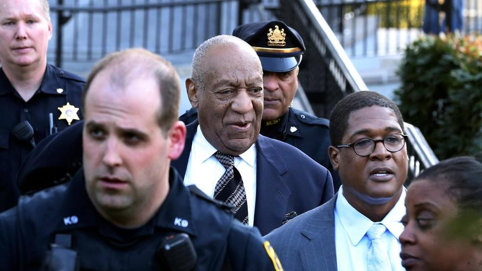 Topless female protester charges at Bill Cosby as retrial